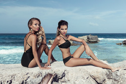 Two beautiful girls on the beach in Zingara swimwear