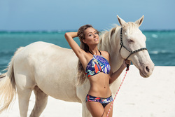 girl with white horse on a beach in Mexico photography
