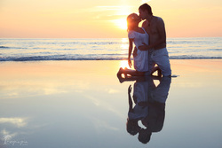 Honeymoon pics of lovely couple on tropical beach