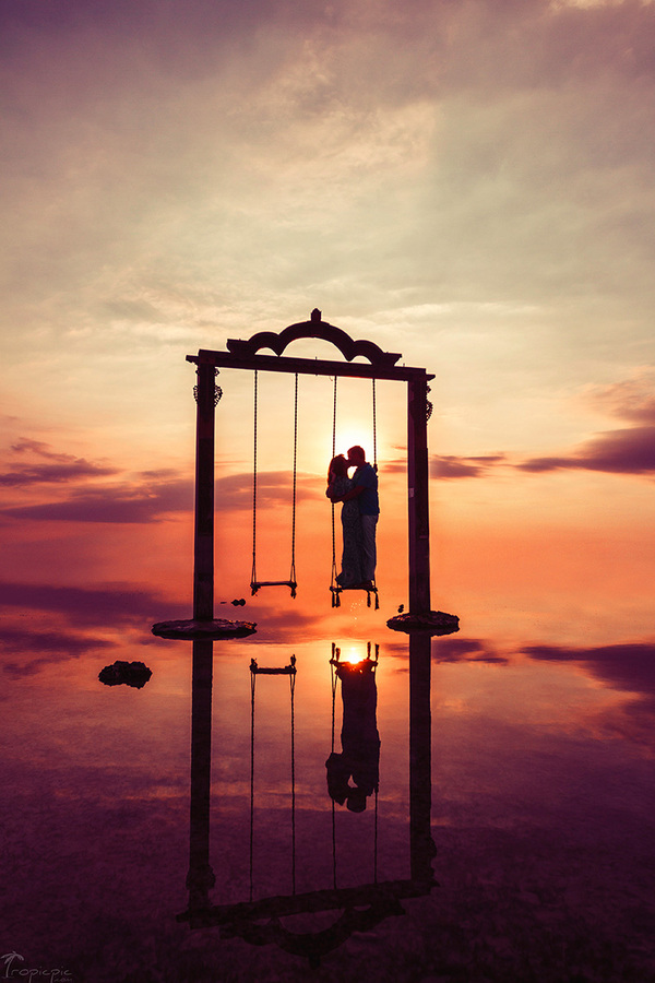 Sunset view on Bali. Swing.